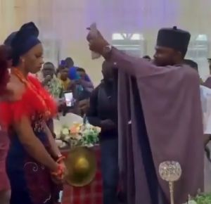 Bride refuses to smile as her husband sprays her with Cash - VIDEO