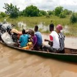 Pregnant women access health care with canoe after rains in North East Region